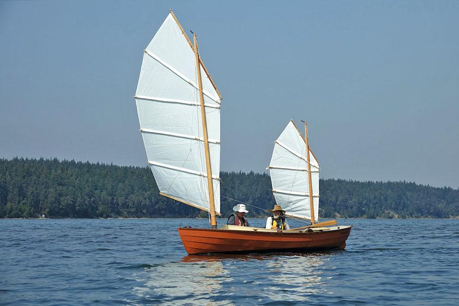 Small junk rigged sailboat.